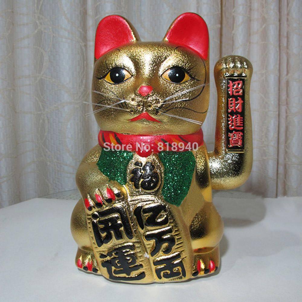 Символ удачи манэки-нэко (maneki-neko).