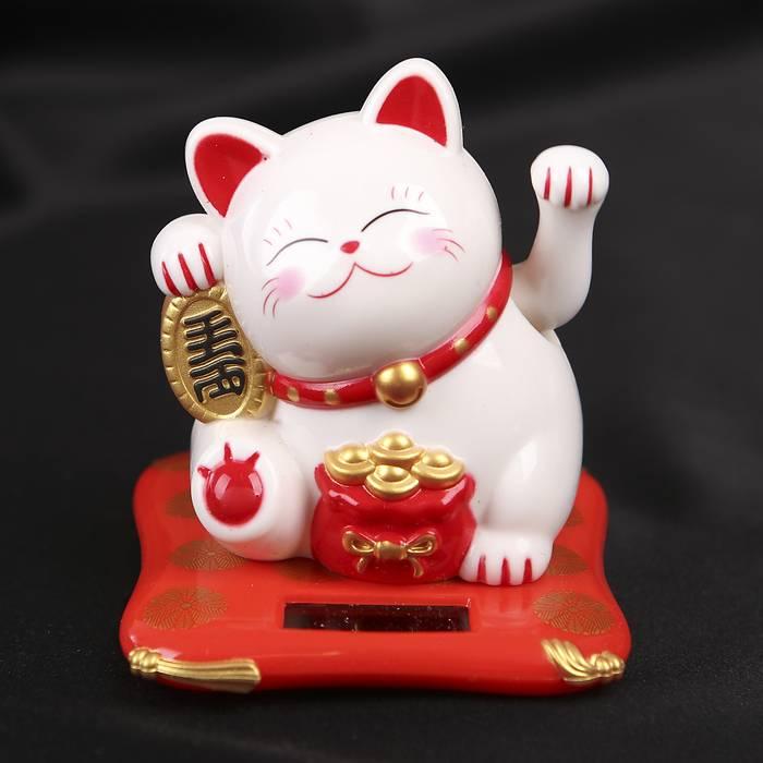 Японский кот приносящий удачу манеки неко: значение и использование талисмана